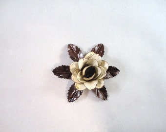 Small Size Decorative Metal Hand Cut and Hand Painted Rustic Cream Color Antique White Color Rose Mounted on a Bed of Leaves.