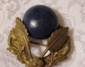 Gold Laurel Pin with Dark Blue Stone