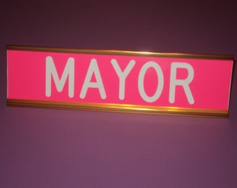 """Custom engraved 2"""" x 8"""" - Pink sign with white letters - with a gold anodized aluminum desk holder"""