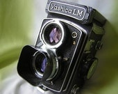 Beautiful Yashica LM medium format camera with FREE film, leather case, lens hood and filter