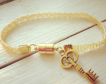 Transparent Gold Bead Loom Bracelet with Key Charm
