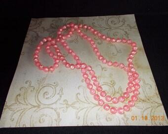 vintage plastic pink string necklace....79