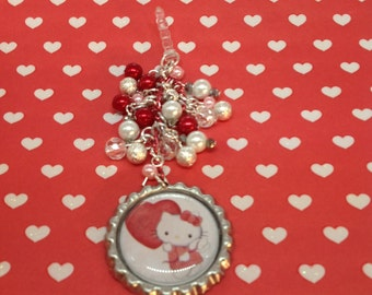 Kitty with a red heart cell phone charm, phone charm, headphone jack charm, dust plug, dust plug charm, iphone charm, ipad charm, bottlecap