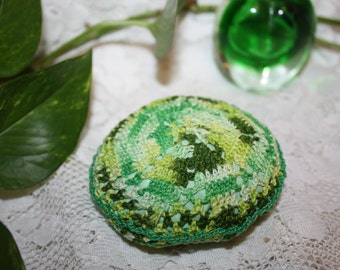 Charming knitted green pincushion