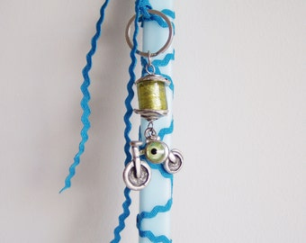 Greek Easter candle for boys, pale blue square candle with bicycle key chain, bicycle Greek Easter lambada, boysand teens bike Easter candle