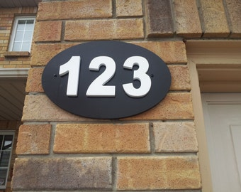 Outdoor house number plaque.  House numbers.  House number sign. House number plaque