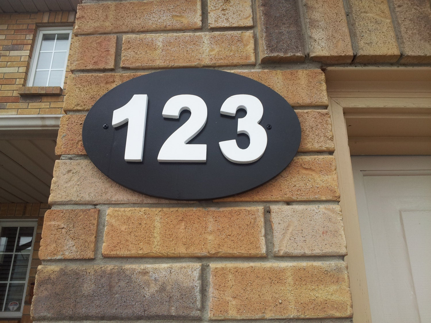 Outdoor house number plaque. House numbers. House number