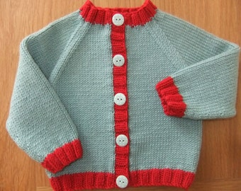 Hand knitted light teal and scarlet baby cardigan - Available to order from size 0-3 months up to 9-12 months