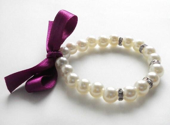 https://www.etsy.com/listing/127508814/flower-girl-pearl-bracelet-purple-ribbon