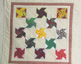 Scrappy pinwheel patchwork doll quilt, table-topper or wallhanging