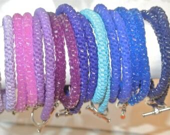 Woven Double Wrap Plastic Bracelet, Color Families- Purples, Blues, Yellows and Greens