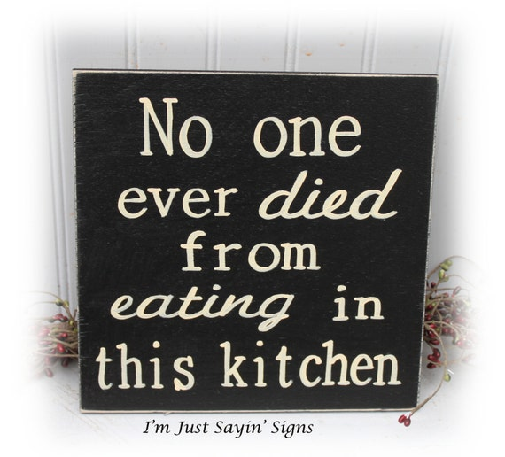 no one ever died from eating in this kitchen wood sign