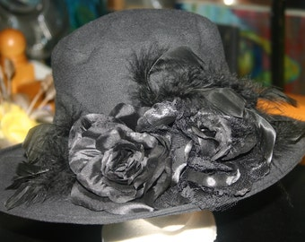 black hat with black flowers and feathers
