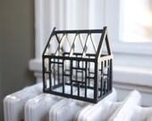 Geometric framework of a miniature house structure in matte black