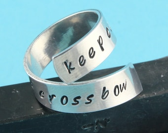 SALE - Keep Calm and Carry A Crossbow Wrap Twist Ring - Adjustable Aluminum Ring - Hand Stamped Ring