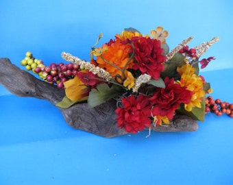 Fall and Winter driftwood centerpiece with fall colored flowers ooak