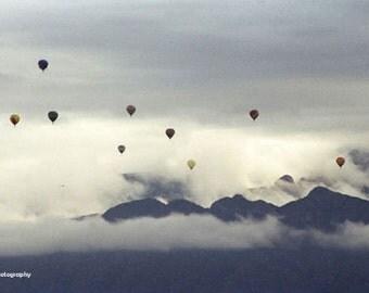 Hot air balloon photography, photos, mountains, Sandias, Albuquerque Balloon Fiesta, flying, New Mexico, Val Isenhower