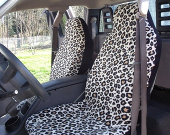 1 Set of Cheetah 2 Print Seat Covers and steering wheel cover.  Custom Made.