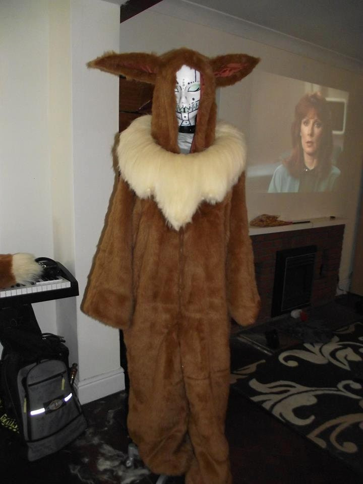 d39c845ecd2d Items similar to Pokemon Eevee custom made fur onesie on Etsy