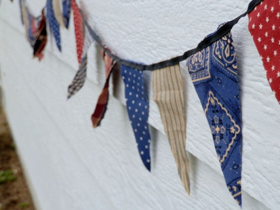 red, tan, and blue patterned pennant banner bunting