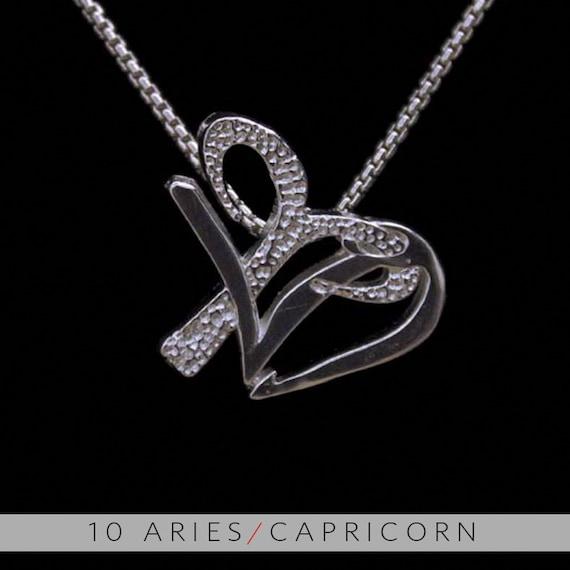 10 aries and capricorn silver unity pendant like this item aloadofball Choice Image