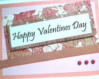 Traditional looking Valentine with pinks and cupids, but with a surprise message inside