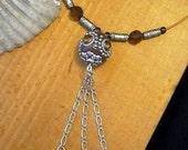 Statement Tassled Pendant Choker in brown tones and silver.