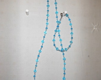 """21""""  necklace and 7 1/2"""" bracelet  earrings blue and clear glass beads"""