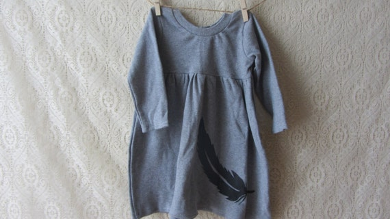 Gray knit baby girl's dress with feather. 12-18 months.