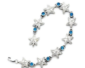 Sterling Silver Starfish Bracelet set with 2.30CTW of London Swiss Faceted Blue Topaz Stones.