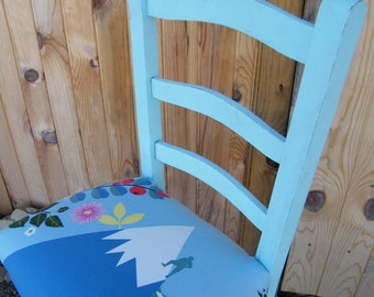 Old chair painted in turquoise clear and upholstered
