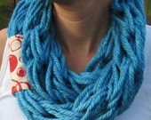 Very soft arm knitted infinity scarf.  Turquoise with red and cream accent material.  100% acrylic