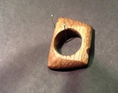 "Rounded square ""shield"" wood ring"