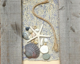 Rope and Beach Finds in a driftwood frame.