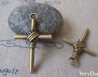 Antique Bronze Coiled Cross Charms 25x40mm  Set of 10 A4376