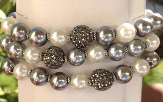 The Supporter Bracelet - platinum faux pearls and black pave bead