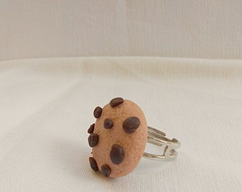 Adjustable ring with polymeric clay cookie