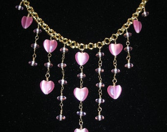 Gold double chain necklace with pink heart and rondelle dangles