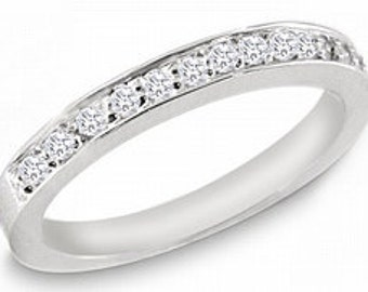 0.33. ctw. Ladies Diamond Band