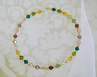 Gold plated bracelet with multicoloured green and purple Swarovski Elements crystals