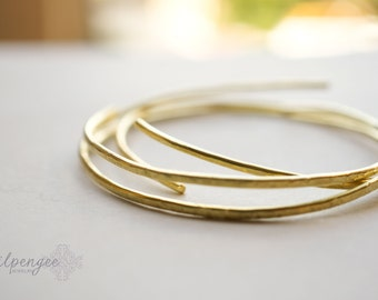 g i l a  - gold brass bangles. adjustable gold bangles. stacking bracelets. arm candy. gold bracelets.
