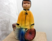 Small vintage ceramic planter of a colorful Asian girl or boy