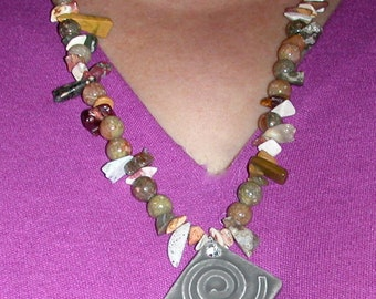 Ceramic Pendant with Spiral on Necklace of Various Neutral Jasper Types and Shapes