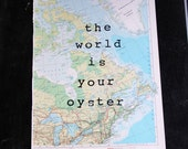 """The World is Your Oyster  hand stamped on vintage atlas map - 10"""" x 14"""" - wall decor"""
