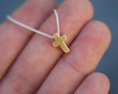 Matte gold Tiny cross charm necklace on delicate silver chain modern everyday minimalism