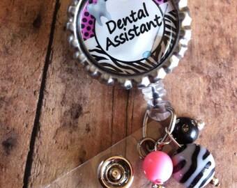 Dental assistant or dental hygienist badge reel retractable