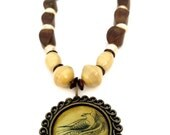 Handmade Beaded Necklace With Wooden Beads, Glass Beads, And A Large Brass Bird On Nest Pendant