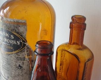 Vintage Amber Bottle collection of three