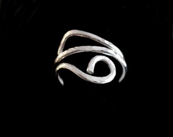 Sterling silver hand forged hammered ring.  adjustable. Finger or thumb ring