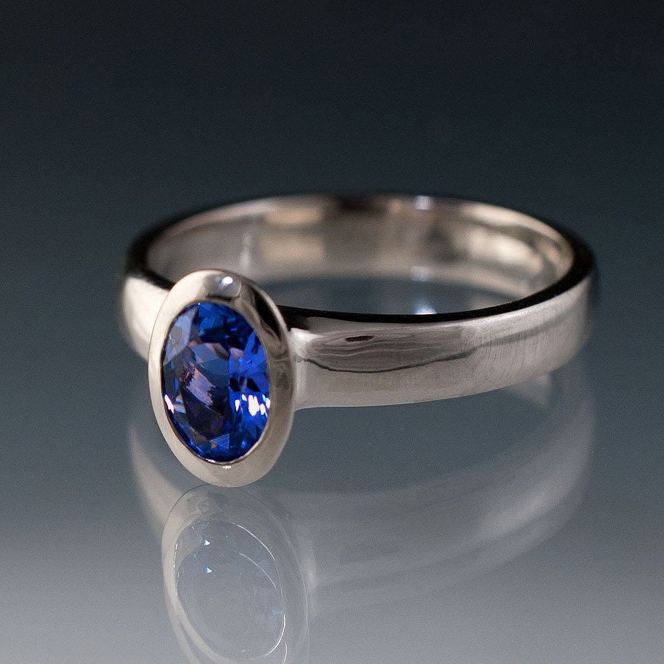 Oval Chatham Blue Sapphire Bezel Solitaire Engagement Ring in